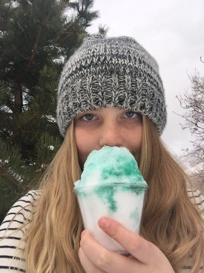 Aubri Rupp holding a snowcone to express her love for snow.
