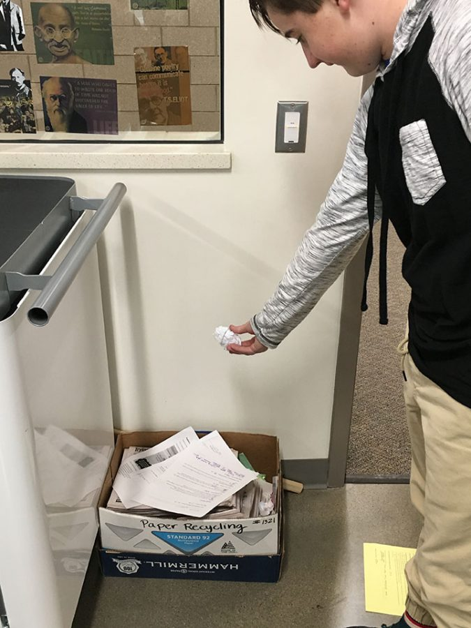 Zack Roberts recycling a piece of paper in Draper, Utah on February 13, 2017.