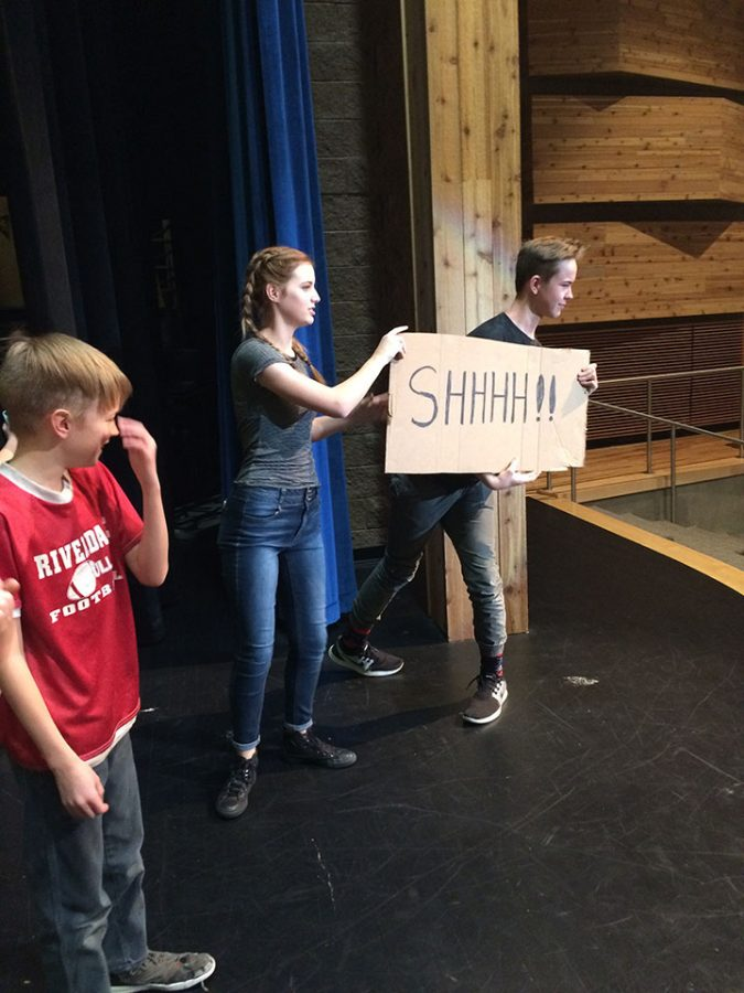 February 23, 2017 Jack Pollock, Mufasa in the Lion King Jr. and Summer Hall, stage manager, encourage cast members to be quiet during rehearsal for the Lion King Jr. Summer Hall is in Productions Company, and the class works on the Lion King music there as well.