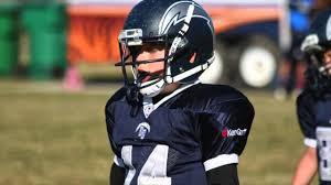 Football safety, Jaeden Whytock, he goes to corner canyon, on a football field, sandy, he was playing football 4/15