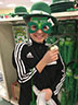 Avery Hartey is trying on some Saint Patrick's Day festive clothing at the Dollar Store,  on February 10, 2017.