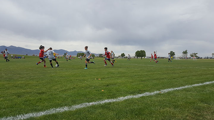 kids are playing soccer, photo taken on 8/16/16, and it was in Utah