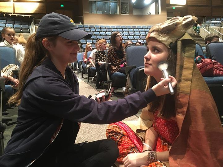 Eve Candell and Summer Hall putting on makeup for the play Lion King at DPMS 2/27/17