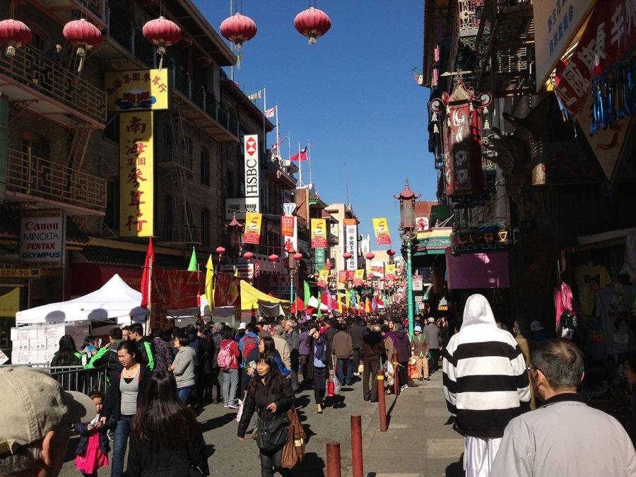 Another street in Chinatown, San Francisco, where there are tourists, and people celebrating all over.