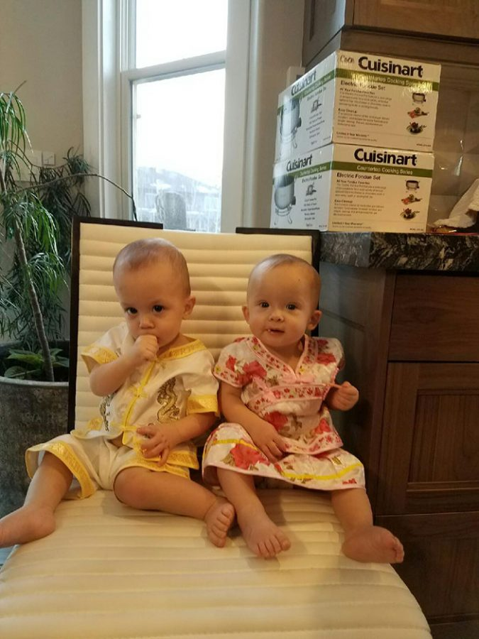 Traditional Chinese clothing mainly worn during Chinese New Year, modeled by babies!