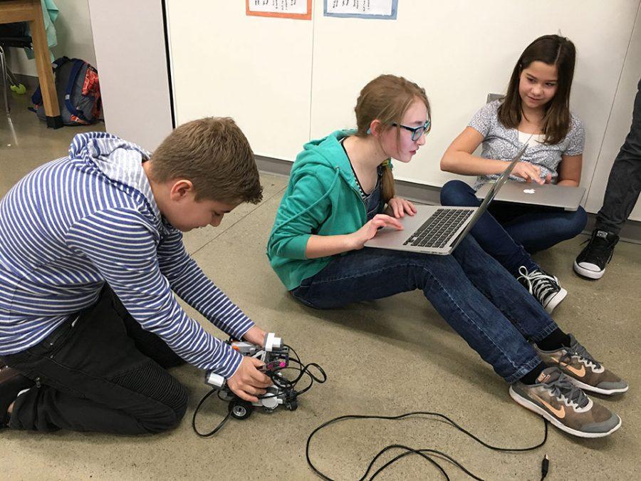 Students playing with their robots and creating programs.