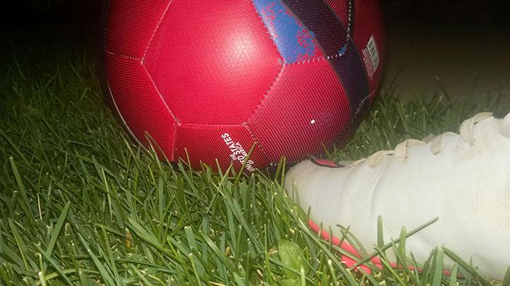 This photo is of a soccer ball and my soccer cleat, it was taken in my front yard at night on 9/27/16.