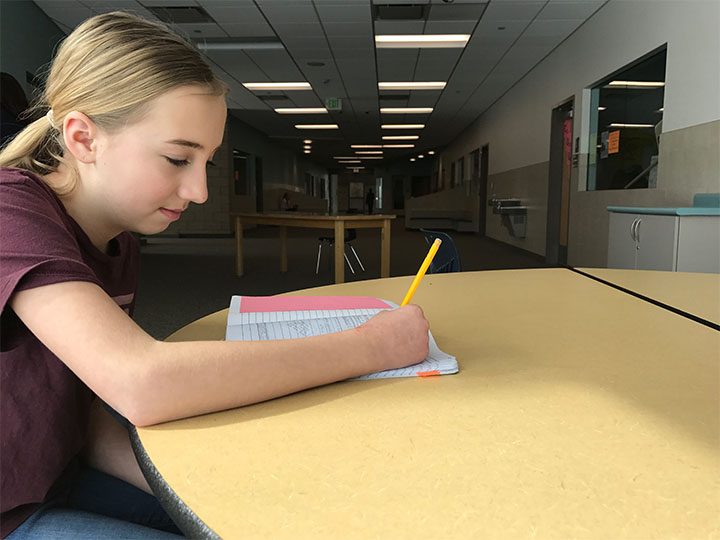 Morgan Brown taking notes for her elective class on February 28th that she wont have to study as much because next year her class will be every day.