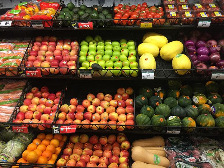 At smiths there are lots of different colored fruits and veggies on the produce isle taken February 21st.