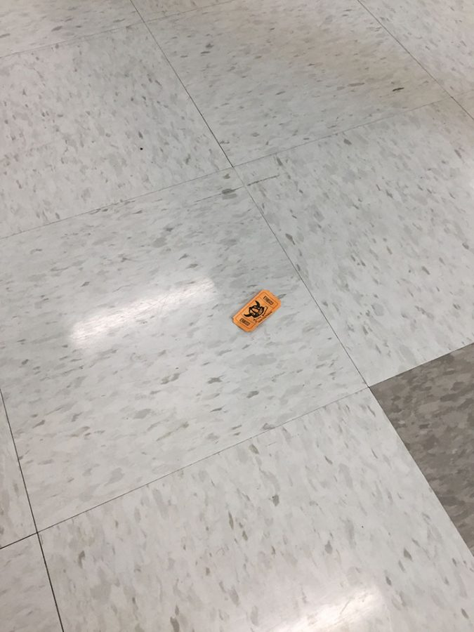 This is a picture of a raffle ticket on the floor that I found. The students love to trade them