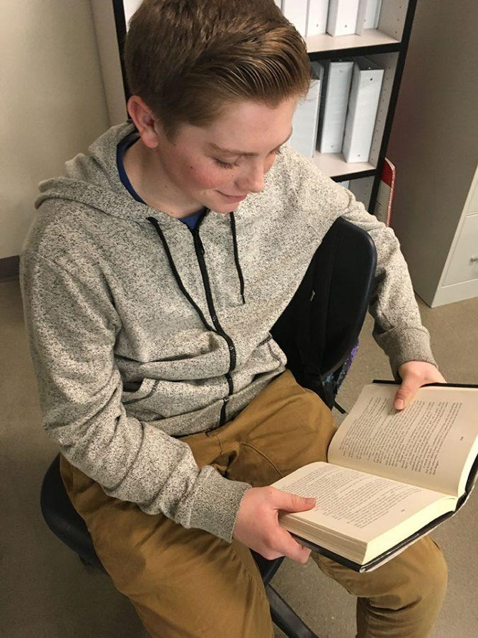 Colton Grimshaw reading a book 2/13/17 at Draper Park Middle School.