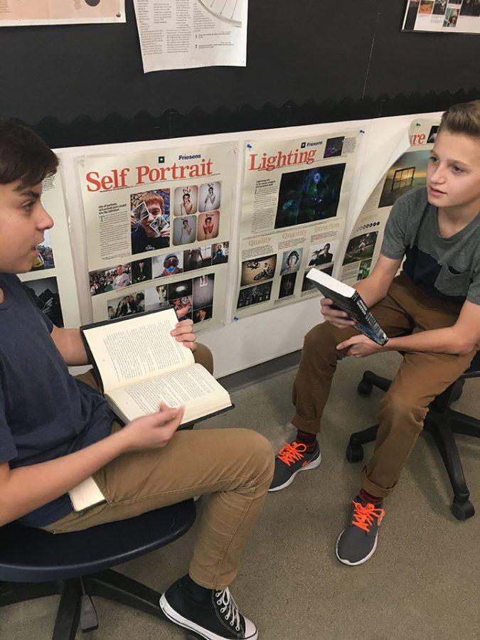 Ethan Webb and Jenson Draper talking about their books. Taken 2/13/17 at Draper Park Middle School.