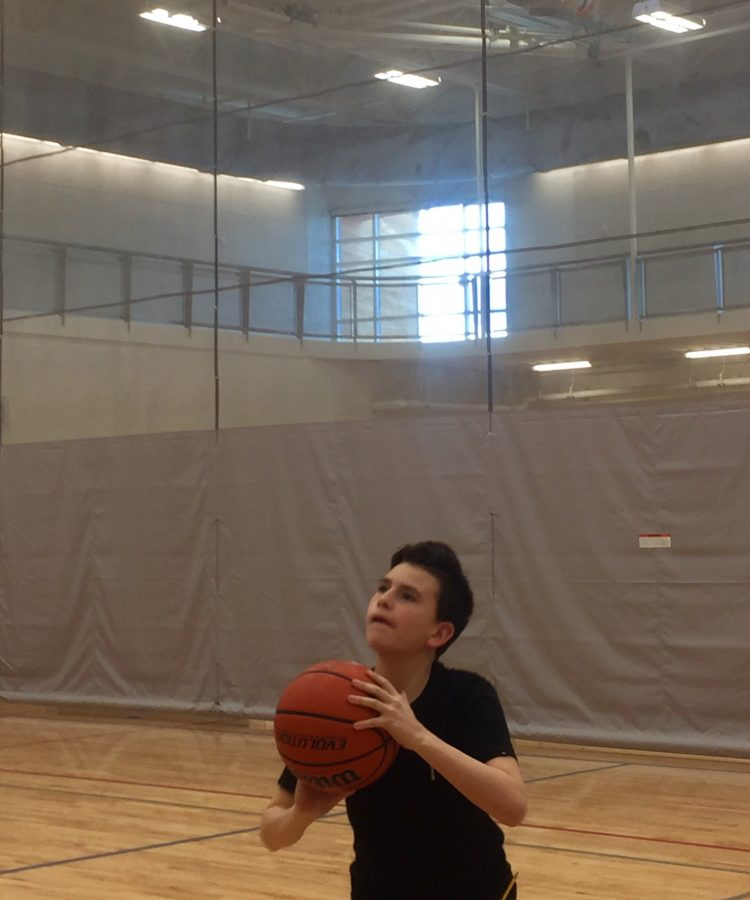 Zach Bautista shooting the basketball