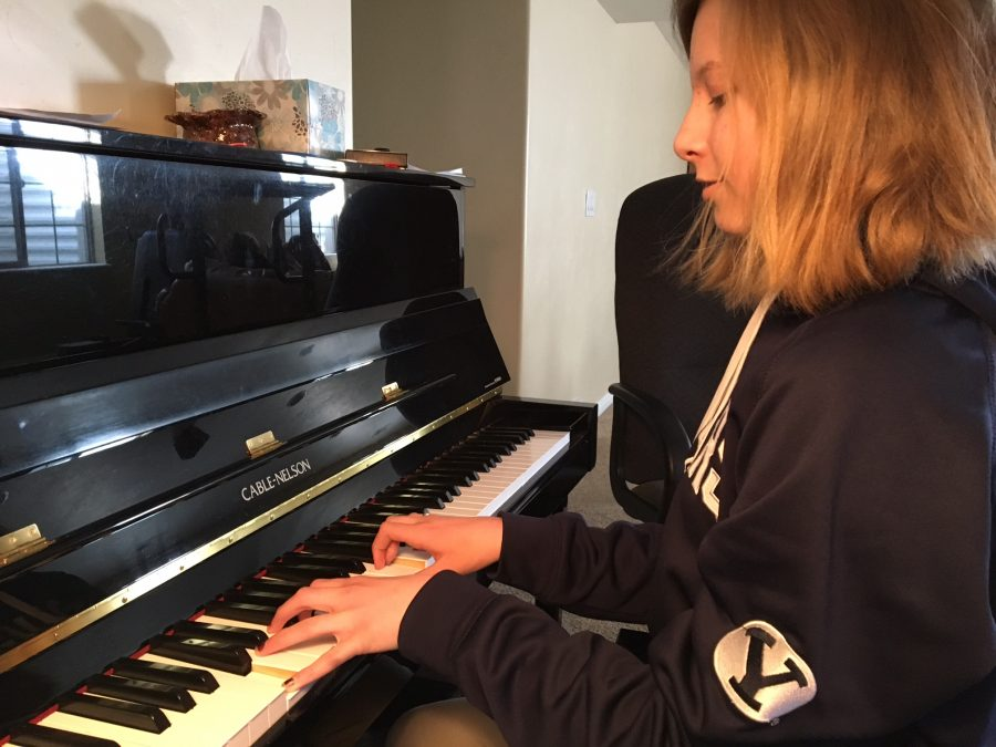 Katie Burnett, 7th grade student, practices the piano for an hour and a half every day. This photo was taken at her house on March 9, 2017.