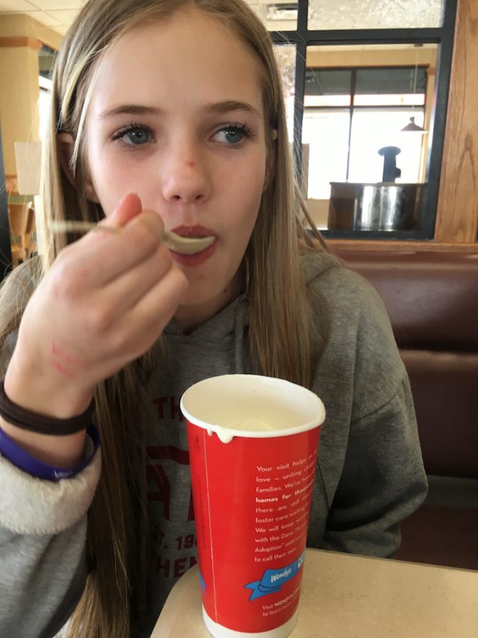 Emma Moody, 7th grader, takes a bite of Wendy's ice cream. Draper, Utah  2/28/17