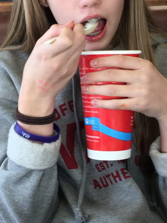 Emma Moody, 7th grader, taking a bite of Wendy's ice cream. Draper, Utah  2/28/17