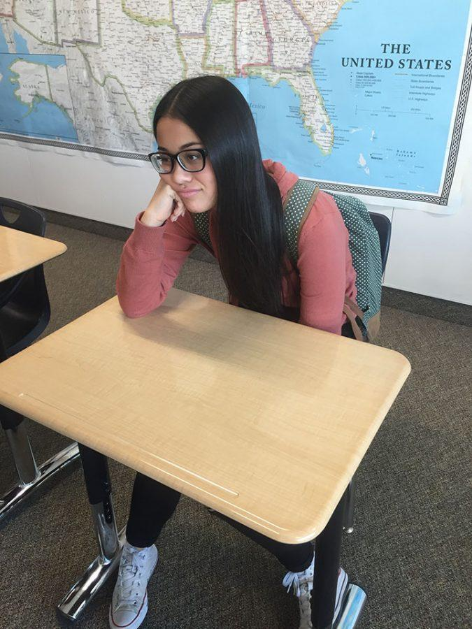 Jade Akagi listens to the teacher during class- doing her best to stay on top of assignments at Draper Park.