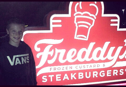 This is Gatlin Jessop in front of the Freddy's sign at Freddy's on February 28, 2017.