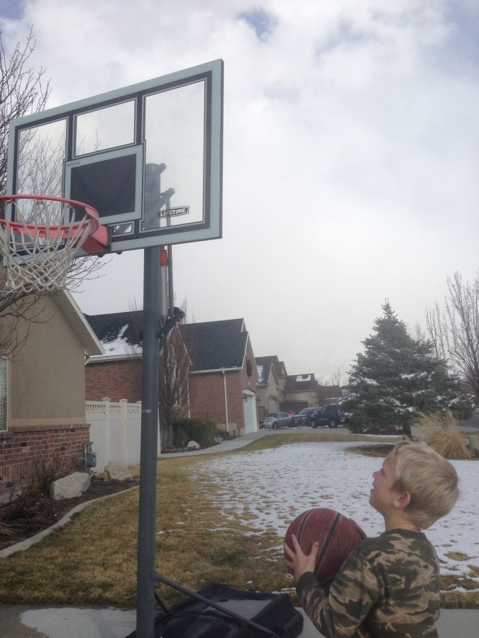 Jace about to shoot a basketball.