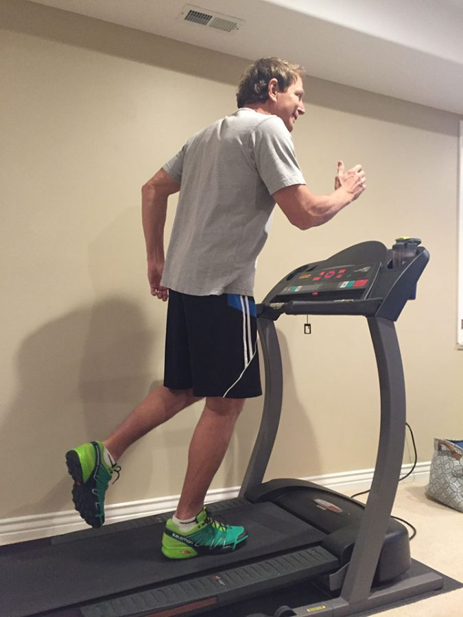 Gregg Bauman, parent of DPMS student, running on a treadmill at home on 2-28-17