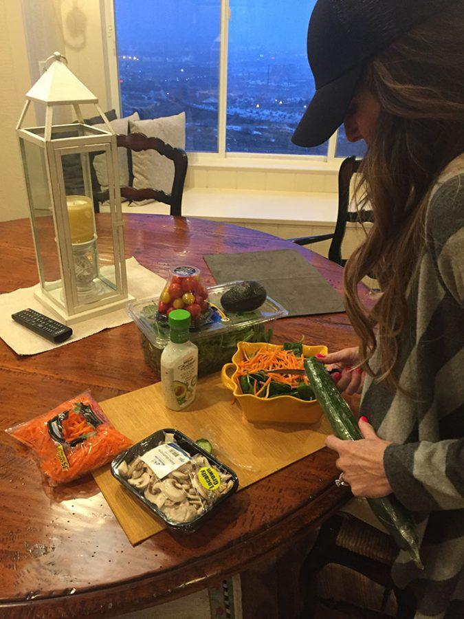 Jacque Bauman, parent of PMS student, making a healthy salad in her kitchen on 2, 28, 17