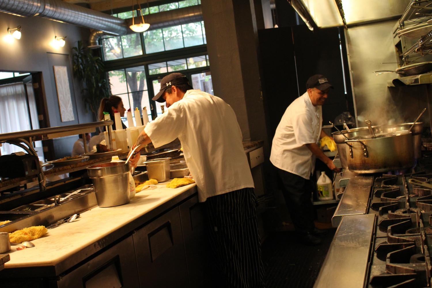 Cucina Toscana's chefs whip up the next order. 4/26/17. Photography by Kira Rhay.