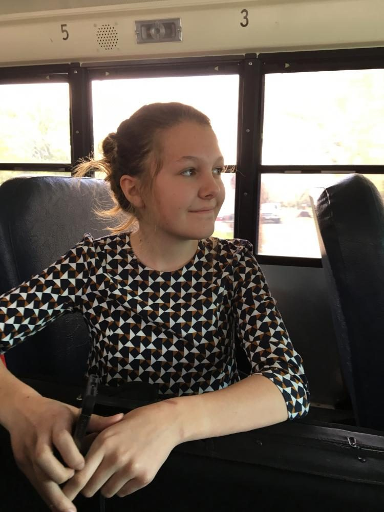 Amy Gardenhire is riding the bus home with her instrument. This photo was taken on April 20, 2017 on her bus route.