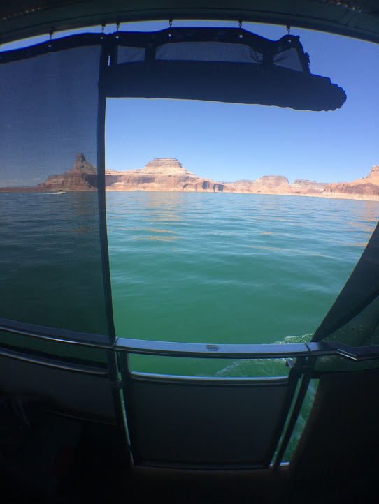 Photo by Brooklyn Leggett. Looking off of a house boat in Lake Powell. Look at the beautiful red rocks.