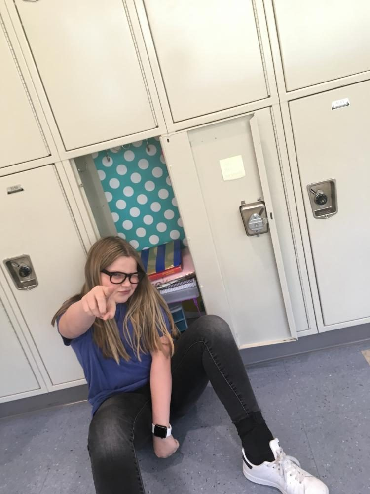 Ellie Ware pointing out how awesome lockers can be, taken on May 12 at DPMS.